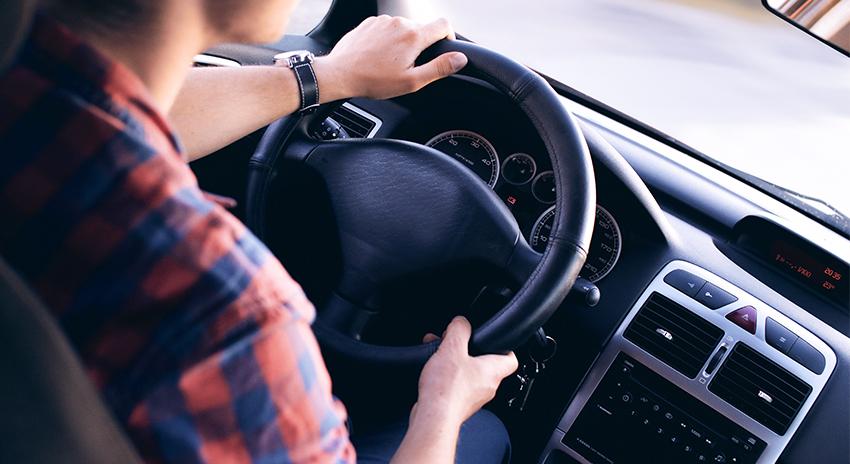 man on steering wheel