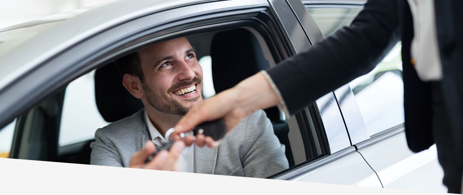 Business man receives key for car